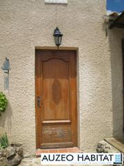Porte d'entrée PVC vitrée.